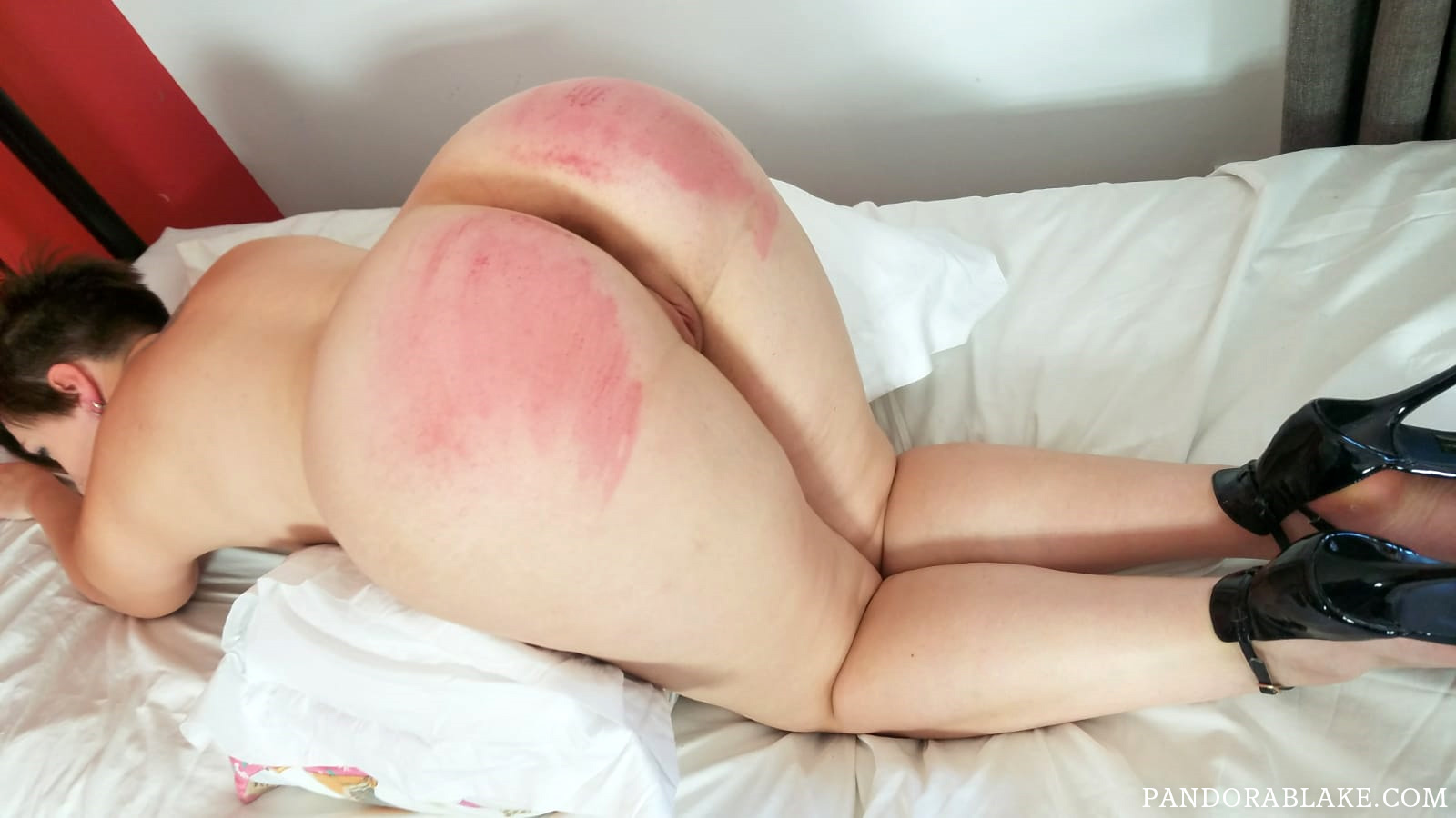 Pandora Blake bends over for a birthday caning from Sarah Gregory
